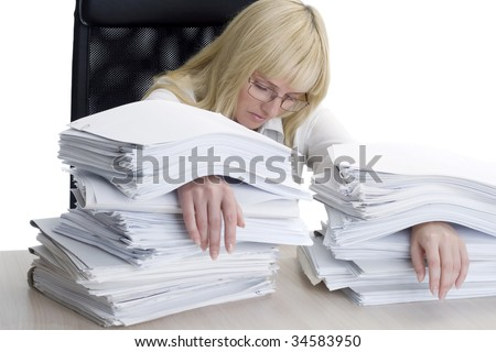 The woman the bookkeeper is filled up by a heap of work