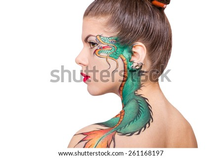 The woman with the dragon tattoo drawn on his shoulder isolated on white background