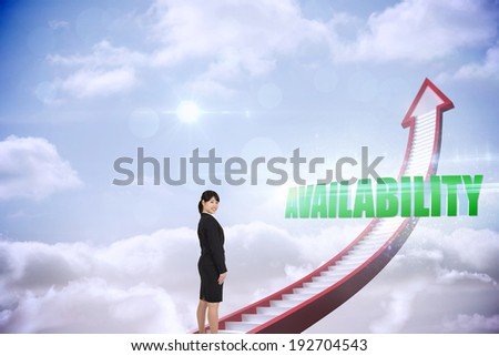 The word availability and smiling businesswoman against red stairs arrow pointing up against sky