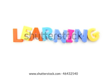 The word learning spelled out using colored fridge magnets, isolated on white