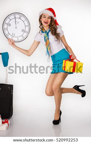 The young, beautiful stewardess holds gift on a white background