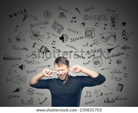 The Young man closed ears on grey background with doodles scetch