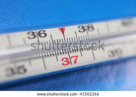 Thermometer on dark blue background. Temperature