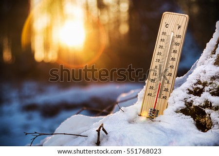 thermometer with low temperature in the snowy woods. Cold weather in the woods
