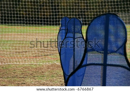 "these blue shapes are used to help players control the ball around opposing defensemen.  They are practice ""dummies"" for soccer"