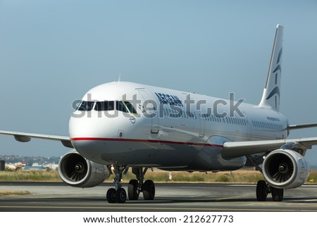 THESSALONIKI, GREECE- MAY 25, 2014: Aircraft operated by Aegean Airlines, ready to take off at International Airport 'Makedonia', Greece. The company in its fleet has 25 aircraft Airbus-A320