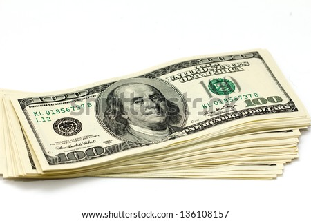 thick stack of hundred-dollar bills isolated on a white background