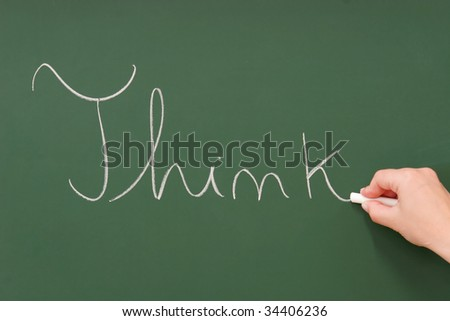 Think written on a blackboard with chalk