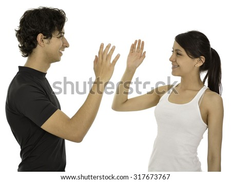 This couple hi five and smile they have a sport clothes.