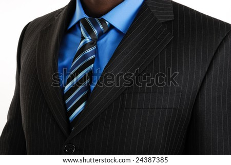 This is a an image of business man wearing a tie, shirt and suit.