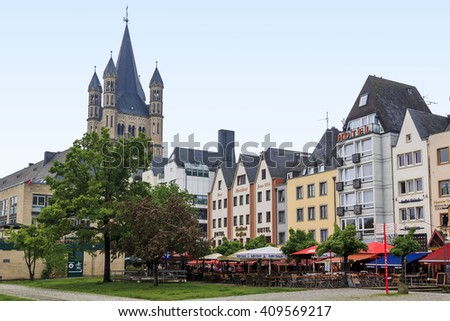 This is quay of the left bank of the Rhine near the Fish Market and the church of St. Martin at foggy evening May 16, 2013 in Cologne, Germany.