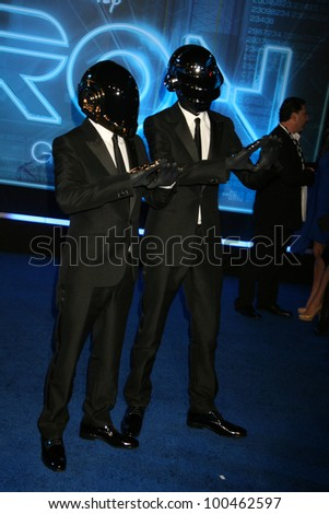 "Thomas Bangalter and Guy-Manuel de at the ""TRON: Legacy"" Los Angeles Premiere, El Capitan, Hollywood, CA. 12-11-10"