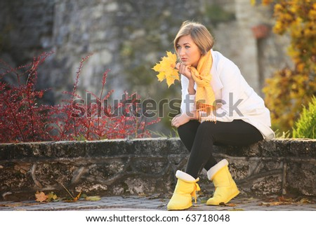 thoughtful beauty relaxing in autumn park - stock photo