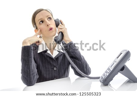 Thoughtful business woman talking on phone.