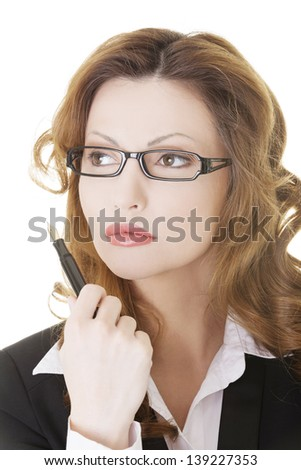 Thoughtful pretty businesswoman, against white background