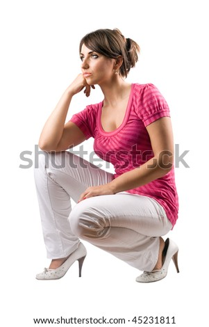Thoughtful pretty woman in the squatting position. Isolated