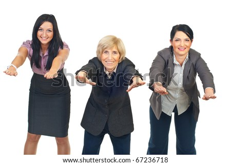 Three active businesswomen in a row doing exercises isolated on white background