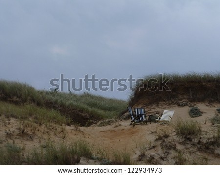 Three beach chairs in a sand dune on Nantucket Island, Massachusetts