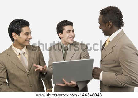 Three businessmen with a laptop