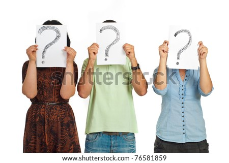 Three casual people standing in a line and holding questions marks isolated on white background