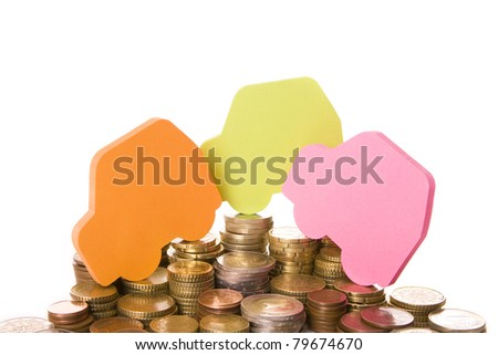 Three colored car shapes over many stacked coins
