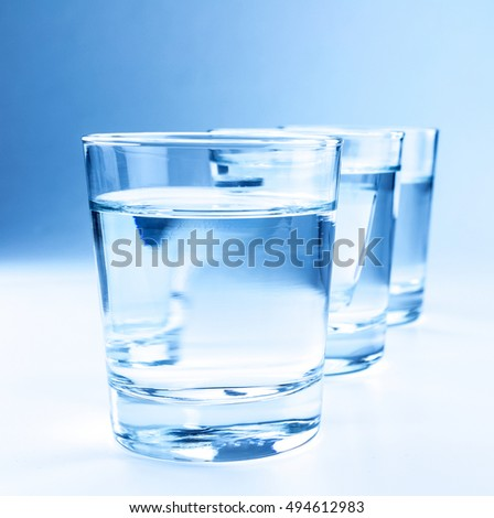 three drink glasses with water, nutrition and health-care concept, nutrition and health-care concept on white background
