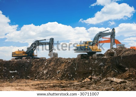 Three excavators working on a constuction site