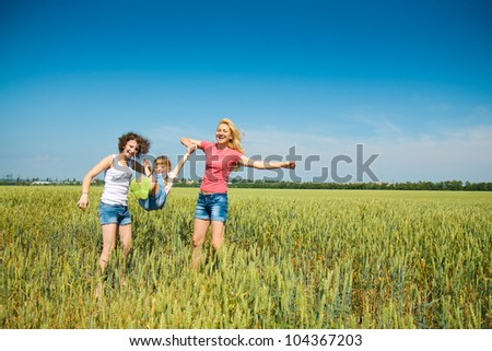 Three families have fun in the field