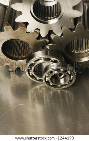 three gear-wheels and bearings in sepia