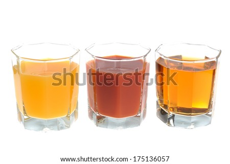 Three glasses filled with various kinds of juice isolated on white background