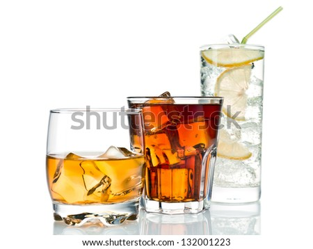 Three glasses of alcoholic and soft drinks