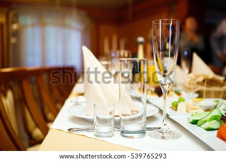 Three glasses on a festive table. Serving at the party. Soft focus, selective focus