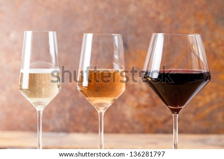 Three goblets with many types of wine