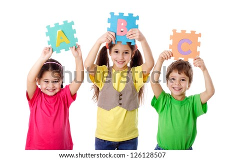 Three kids with colorful letters in raised hands, isolated on white