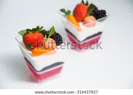 Three layer samples Panna cotta fruit on top
