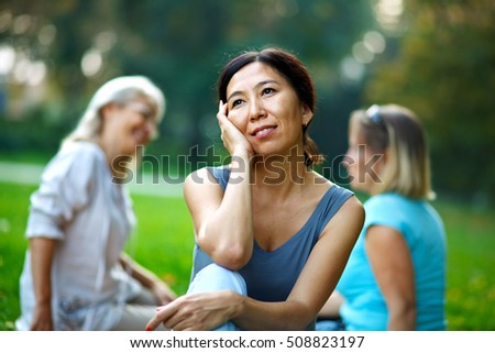 Three mature ladies hanging out in the nature
