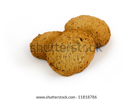 Three oatmeal cookies with raisins isolated on a white background with shadow. Clipping path included.