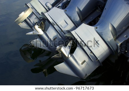Three outboard boat motors