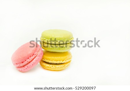 Three pieces of sweet macarons on white background