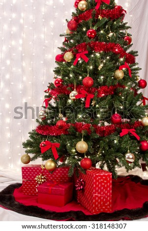 Three wrapped Gifts under a Christmas tree