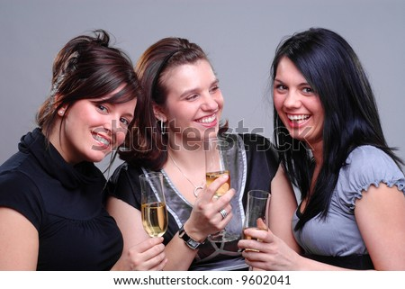 Three Young Women Enjoying Champagne At A Party