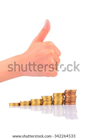 Thumb-up sign on stack of coins isolated on white background