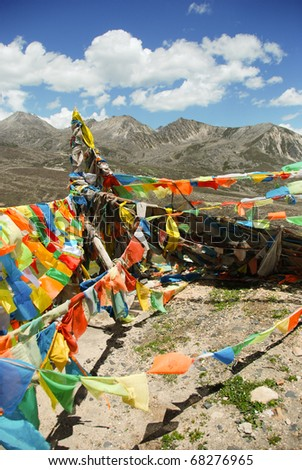 Tibetan Prayer flags tied to a stupa high in the Himalayas, China