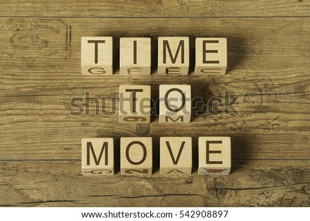 time to move text on cubes on wooden background