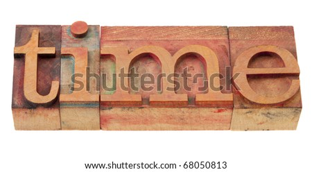 time - word in vintage wooden letterpress printing blocks, stained by color inks, isolated on white