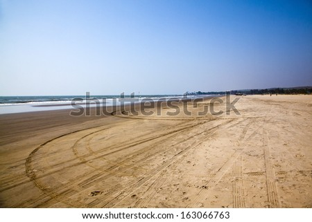 Tire tracks and footprints on the beach, Morjim, Pernem, Goa, India