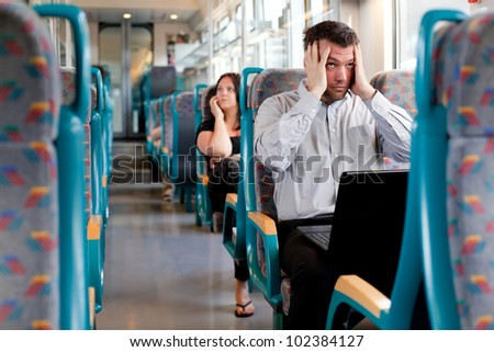 Tired businessman under a lot of stress on the train