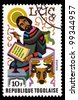 TOGO - CIRCA 1978: A post stamp printed in the Republic of Togo shows Luke the Evangelist, circa 1978 - stock