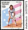 TOGO - CIRCA 1996: A stamp printed in Togo showing female tennis player, devoted olympic games in Atlanta, circa 1996 - stock photo