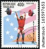 TOGO - CIRCA 1996: A stamp printed in Togo shows weightlifting, circa 1996 - stock photo